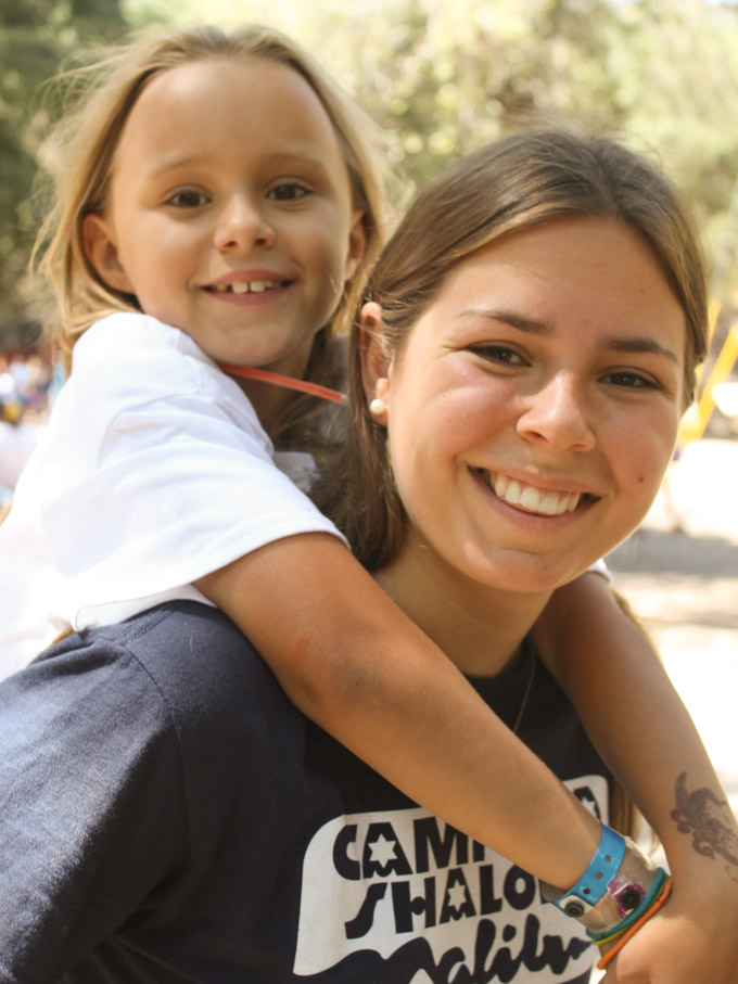 camper-counselor-piggy-back